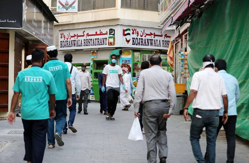 DUBAI, UNITED ARAB EMIRATES , April 27 – 2020 :- People walking on the streets in Al Ras area in Deira Dubai. Authorities ease the restriction for the residents after almost a month long locked down of Al Ras district. (Pawan Singh / The National) For News/Standalone/Online/Instagram