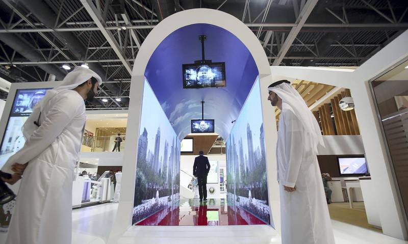 Dubai, 08, Oct, 2017 : Visitors take a look at the new Smart Tunnel at the  Dubai Naturalization and Residency stand during the  37th Gitex Technology Week at the World Trade Centre in Dubai. Satish Kumar / For the National