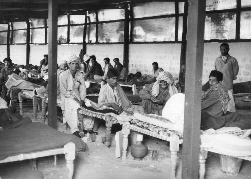 FOR MALARIA / SMALPOX GALLERY.  11th January 1962:  An overcrowded emergency smallpox ward in Karachi, with an earth floor, corrugated iron roof and rudimentary furnishings, during the worst outbreak of the disease in Pakistan's history.  (Photo by Keystone Features/Getty Images)
