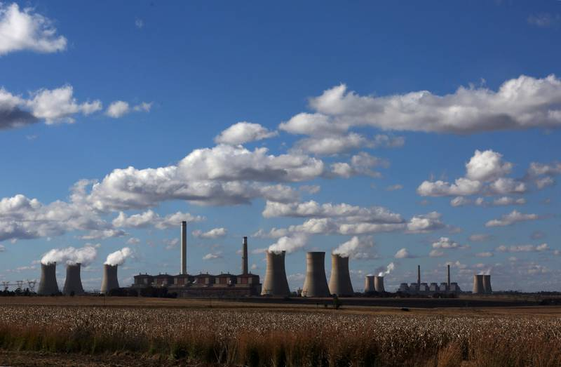 FILE PHOTO: Steam rises from the cooling towers of Matla Power Station, a coal-fired power plant operated by Eskom in Mpumalanga province, South Africa, May 20, 2018. REUTERS/Siphiwe Sibeko/File Photo