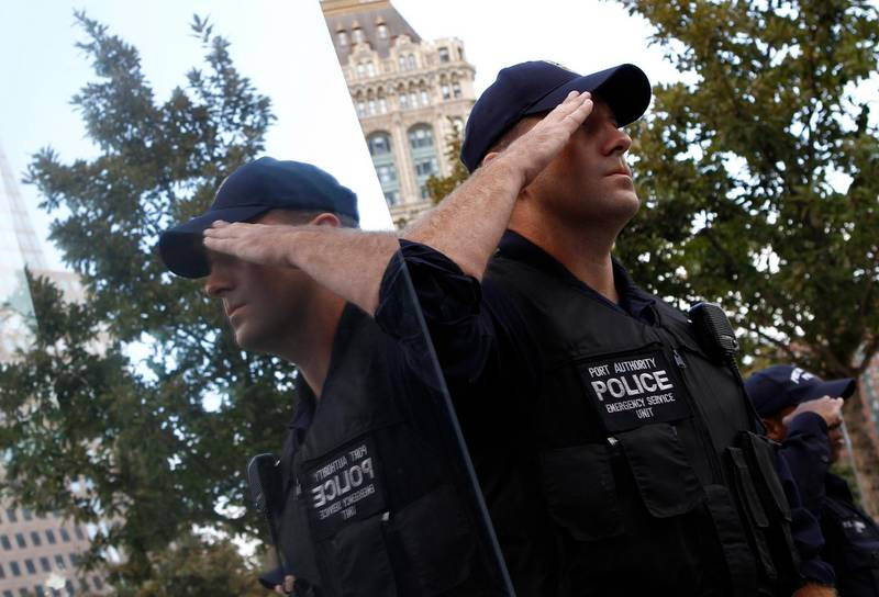 A Port Authority police officer salutes during ceremonies marking the 10th anniversary of the 9/11 attacks on the World Trade Center in New York, September 11, 2011.  REUTERS/Jim Young   (UNITED STATES - Tags: DISASTER ANNIVERSARY TPX IMAGES OF THE DAY) *** Local Caption ***  WTC818_SEPT11-_0911_11.JPG