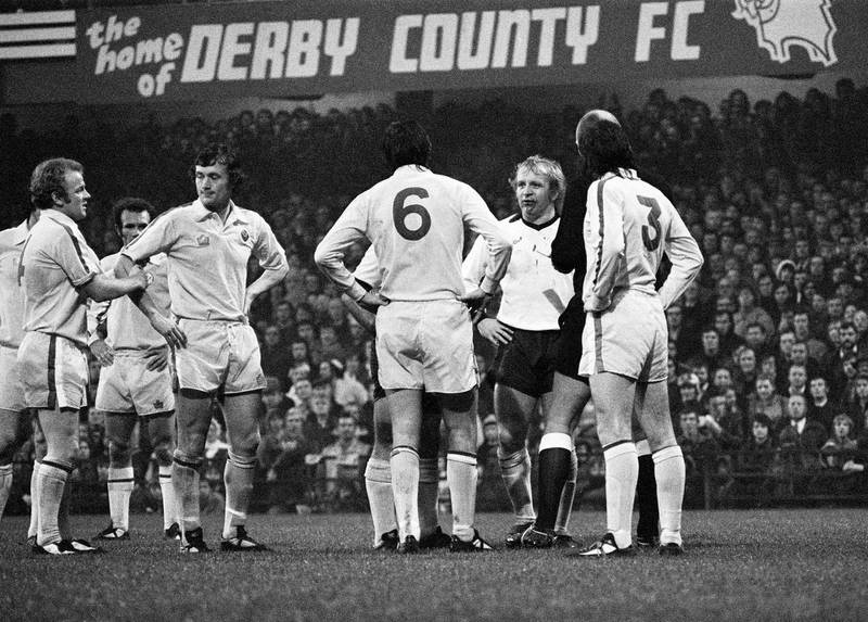 English League Division One match at the Baseball Ground. Derby County 3 v Leeds United 2. Francis Lee and Norman Hunter stare at each other after their punch up, 1st November 1975. (Photo by Dick Williams/Mirrorpix/Getty Images)