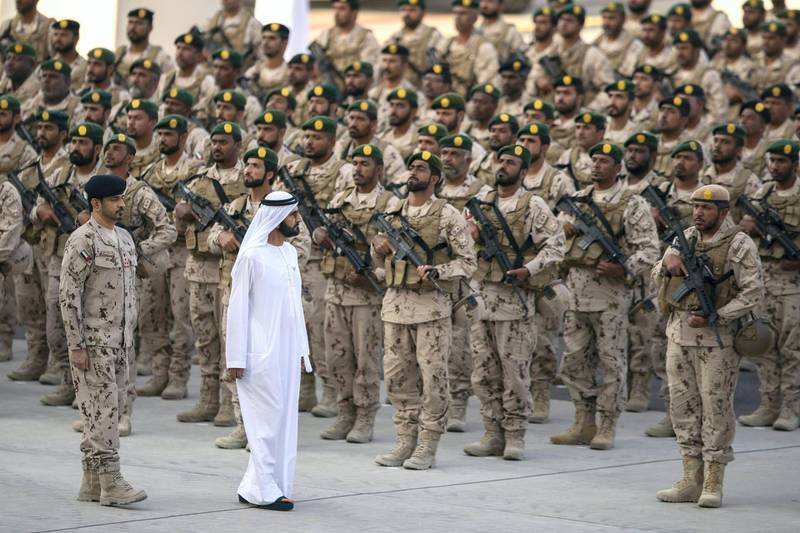 SWEIHAN, ABU DHABI, UNITED ARAB EMIRATES - February 09, 2020: HH Sheikh Mohamed bin Rashid Al Maktoum, Vice-President, Prime Minister of the UAE, Ruler of Dubai and Minister of Defence (2nd L), inspects military personnel during a reception to celebrate and honor members of the UAE Armed Forces who participated in the Arab coalition in Yemen, at Zayed Military City.  ( Abdullah Al Junaibi for the Ministry of Presidential Affairs ) ---