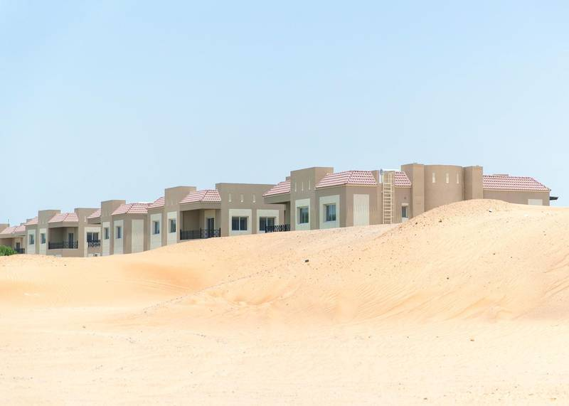 DUBAI, UNITED ARAB EMIRATES - JULY 15 2019.Sand mounds build up by the villas at Living Legends.Some residents and investors of Living Legends have paid Dh6m for villas, and pay Dh25,000 a year in service charges but the development still looks like a construction site, with an unfinished golf course, roads, open sewer works near the school, poor lighting and no desert boundary meaning dangerous snakes and animals are regularly getting into the gardens and villas. (Photo by Reem Mohammed/The National)Reporter: NICK WEBSTERSection: NA