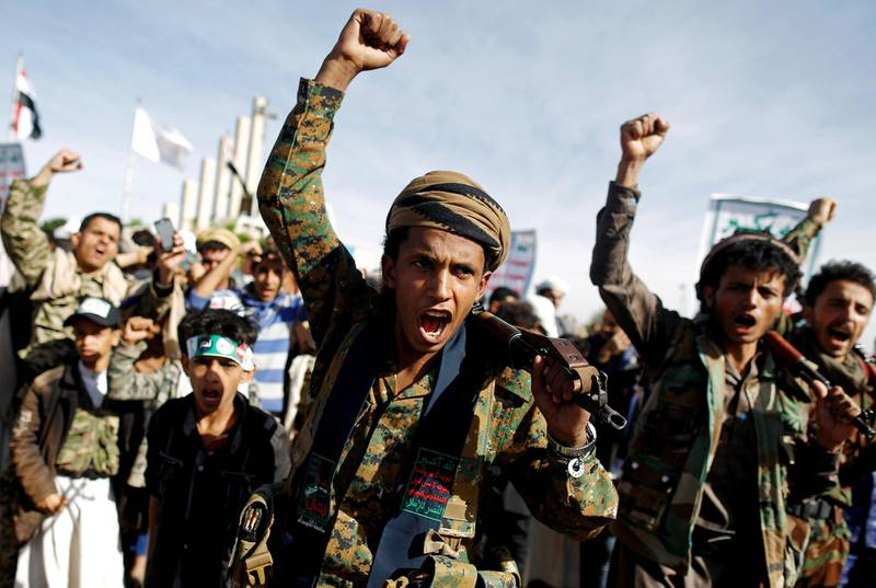 FILE PHOTO: Supporters of the Houthi movement shout slogans as they attend a rally to mark the 4th anniversary of the Saudi-led military intervention in Yemen's war, in Sanaa, Yemen March 26, 2019. REUTERS/Khaled Abdullah/File Photo