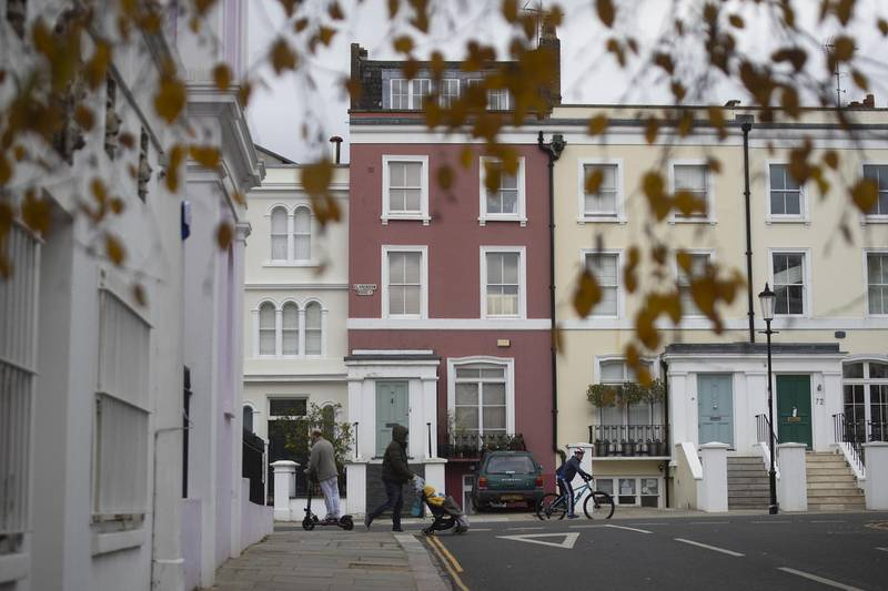 A pedestrian walks past residential houses in the Notting Hill district of London, U.K., on Tuesday, Nov. 24, 2020. Asking prices for U.K. homes slipped this month as owners sought to get sales agreed in time to benefit from a temporary tax cut. Photographer: Simon Dawson/Bloomberg Photographer: Simon Dawson/Bloomberg