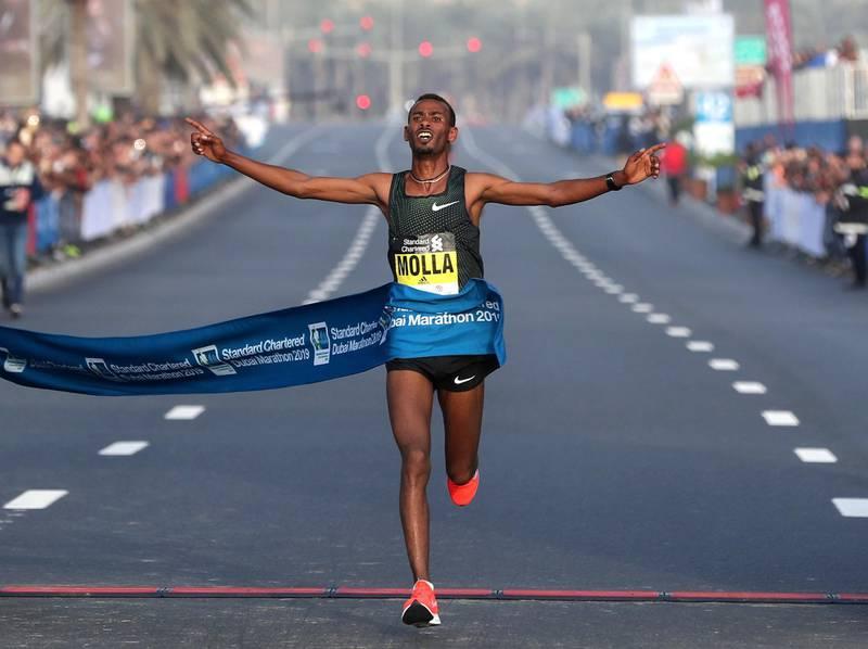 Dubai, United Arab Emirates - January 25, 2019: Getaneh Tamire Molla wins the mens Standard Chartered Dubai Marathon 2019. Friday, January 25th, 2019 at Jumeirah, Dubai. Chris Whiteoak/The National