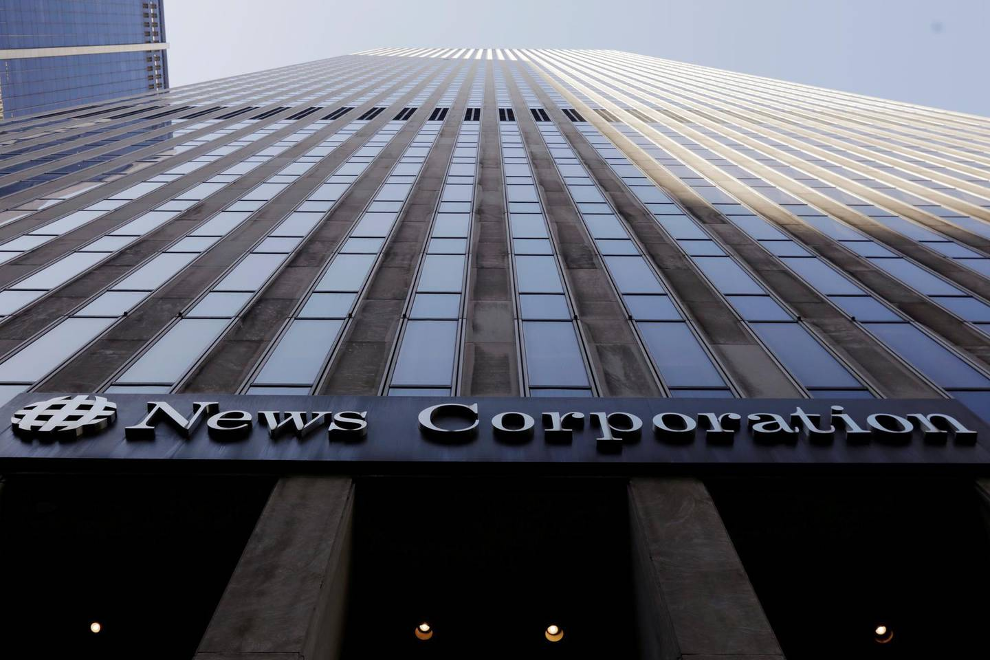 FILE PHOTO: The News Corporation logo is displayed on the side of a building in midtown Manhattan in New York, U.S., February 27, 2018.  REUTERS/Lucas Jackson/File Photo