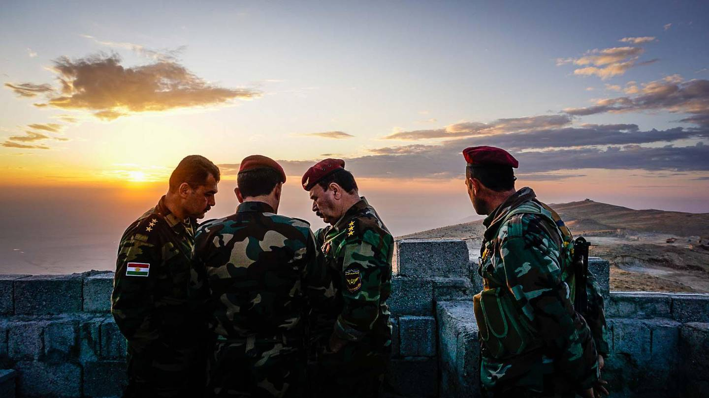 Peshmerga fighters discuss plans at an outpost in the Qara Chokh mountains in northern Iraq. Jack Moore / The National