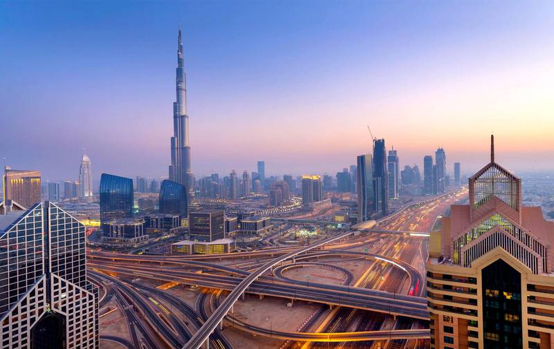 Dubai sky line with traffic junction and Burj Khalifa. Getty Images
