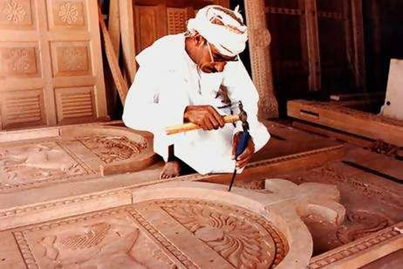 caption for this: Mr Hamdoon works in his wood carving workshop at Nizwa, Oman   Saleh Al-Shaibany/The National?