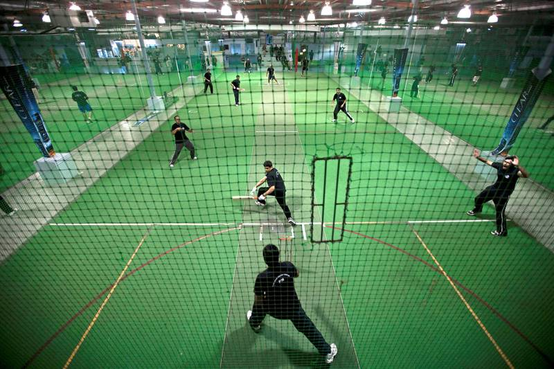 Dubai - August 17, 2010 - The Ramadan Cricket League teams play on small, netted, indoor courts at The Chevrolet Insportz club In the Al Quoz area in Dubai, August 17, 2010. (Photo by Jeff Topping/The National)