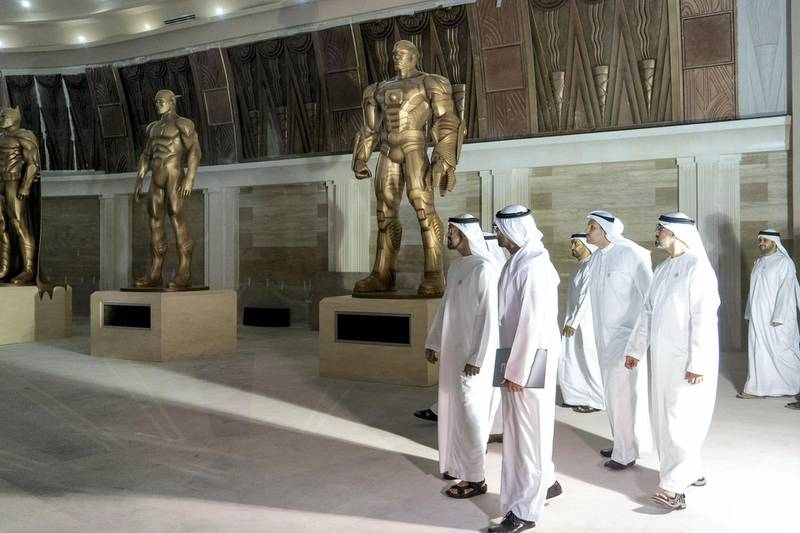 Yas Island, ABU DHABI, UNITED ARAB EMIRATES - March 1, 2018: HH Sheikh Mohamed bin Zayed Al Nahyan, Crown Prince of Abu Dhabi and Deputy Supreme Commander of the UAE Armed Forces (2nd R), inspects the Construction  site of Warner Bros Abu Dhabi. Seen with HE Mohamed Khalifa Al Mubarak, Chairman of the Department of Culture and Tourism and Abu Dhabi Executive Council Member (R), HH Major General Sheikh Khaled bin Mohamed bin Zayed Al Nahyan, Deputy National Security Adviser (back R) and HE Khaldoon Khalifa Al Mubarak, CEO and Managing Director Mubadala, Chairman of the Abu Dhabi Executive Affairs Authority and Abu Dhabi Executive Council Member (back 2nd R).  ( Rashed Al Mansoori / Crown Prince Court - Abu Dhabi ) ---