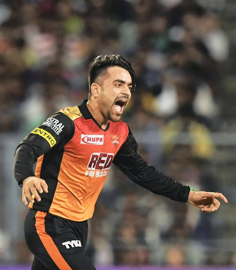 Sunrisers Hyderabad cricketer Rashid Khan celebrates after taking the wicket of Kolkata Knight Riders cricketer Andre Russell during the 2018 Indian Premier League(IPL) Twenty20 second Qualifier cricket match between Kolkata Knight Riders and Sunrisers Hyderabad at The Eden Gardens Cricket Stadium in Kolkata on May 25, 2018.  / AFP PHOTO / Dibyangshu SARKAR / ----IMAGE RESTRICTED TO EDITORIAL USE - STRICTLY NO COMMERCIAL USE----- / GETTYOUT
