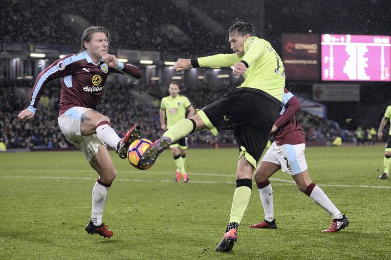 Bournemouth's English midfielder Charlie Daniels (R) vies with Burnley's Irish midfielder Jeff Hendrick during the English Premier League football match between Burnley and Bournemouth at Turf Moor in Burnley, north west England on December 10, 2016. Burnley won the game 3-2. / AFP PHOTO / Oli SCARFF / RESTRICTED TO EDITORIAL USE. No use with unauthorized audio, video, data, fixture lists, club/league logos or 'live' services. Online in-match use limited to 75 images, no video emulation. No use in betting, games or single club/league/player publications.  /