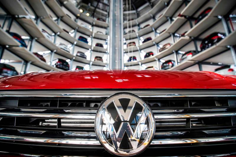 (FILES) In this file photo taken on March 14, 2017 German carmaker Volkswagen's cars are seen at the storage facility auto tower  at the company headquarters in Wolfsburg.    The world's largest carmaker Volkswagen said on February 23, it more than doubled net profits in 2017 compared with the previous year, booking an 11.4-billion-euro ($14 billion) bottom line. / AFP PHOTO / Odd ANDERSEN