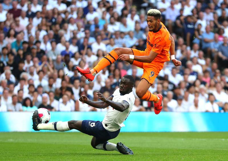 LONDON, ENGLAND - AUGUST 25: Joelinton of Newcastle United is challenged by Davinson Sanchez of Tottenham Hotspur during the Premier League match between Tottenham Hotspur and Newcastle United at Tottenham Hotspur Stadium on August 25, 2019 in London, United Kingdom. (Photo by Catherine Ivill/Getty Images)