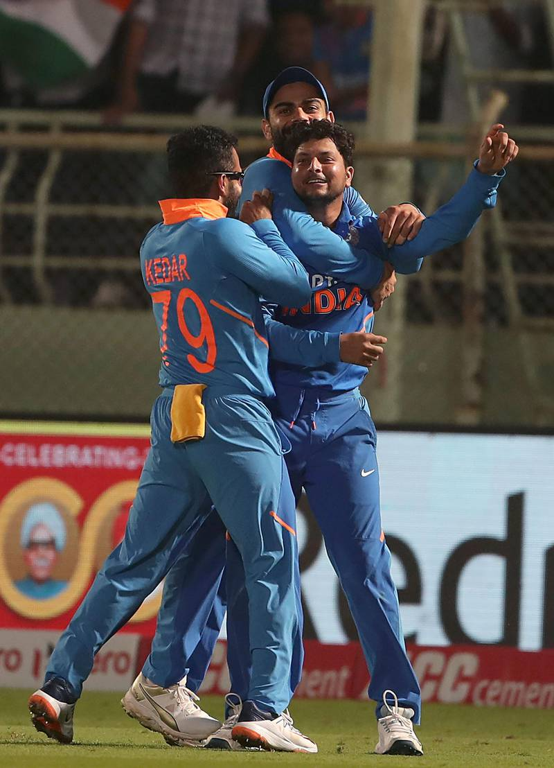 India's Kuldeep Yadav (C) celebrates with teammates a hat-trick of dismissals during the second one day international (ODI) cricket match between India and the West Indies in Visakhapatnam on December 18, 2019.  - ----IMAGE RESTRICTED TO EDITORIAL USE - STRICTLY NO COMMERCIAL USE-----  / AFP / STR / ----IMAGE RESTRICTED TO EDITORIAL USE - STRICTLY NO COMMERCIAL USE-----