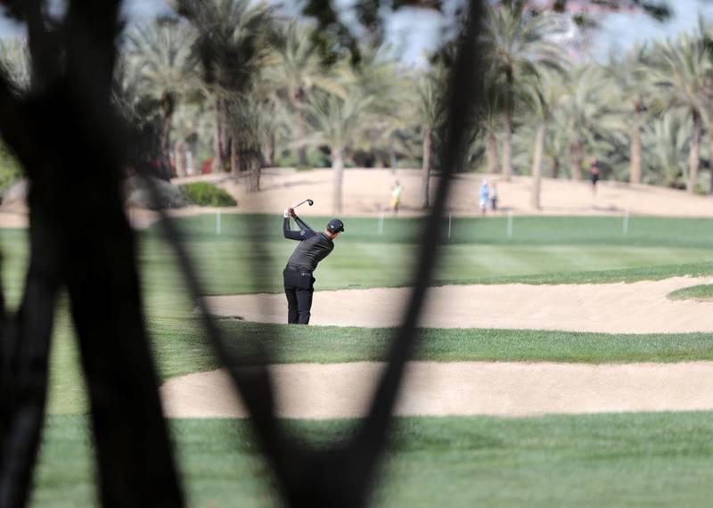 Abu Dhabi, United Arab Emirates - Reporter: Paul Radley and John McAuley: Haotong Li plays a shot on the 8th hole on the 4th and final day of the Abu Dhabi HSBC Championships. Sunday, January 19th, 2020. Abu Dhabi Golf Club, Abu Dhabi. Chris Whiteoak / The National