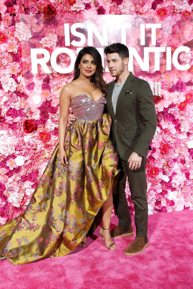 epa07363534 Indian-born US actress/cast member Priyanka Chopra (L) and her husband US singer Nick Jonas arrive for the world premiere of 'Isn't It Romantic' at The Theatre at Ace Hotel in Los Angeles, California, USA, late 11 February 2019. The movie opens in the US on 13 February 2019.  EPA-EFE/NINA PROMMER