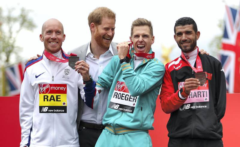 LONDON, ENGLAND - APRIL 28: Derek Rae of Great Britain (2nd), Michael Roger of Australia (1st) and Abdehadi El Harti of Morocco (3rd) all celebrate their respective finishing positions in the T46 Men's race with Prince Harry, Duke of Sussex during the 2019 Virgin Money London Marathon in the United Kingdom on April 28, 2019 in London, England. (Photo by Naomi Baker/Getty Images)