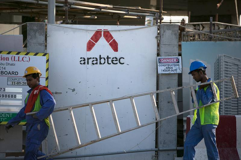 ABU DHABI, UNITED ARAB EMIRATES, Nov. 13, 2013:    Arabtec signage announces yet another projects for teh development company, as seen on Thursday, Nov. 13, 2013, at a residential unit construction site on Reem Island in Abu Dhabi. (Silvia Razgova / The National)  Section:  Business Publication: Undated Reporter: stock    *** Local Caption ***  SR-131113-arabtec04.jpg