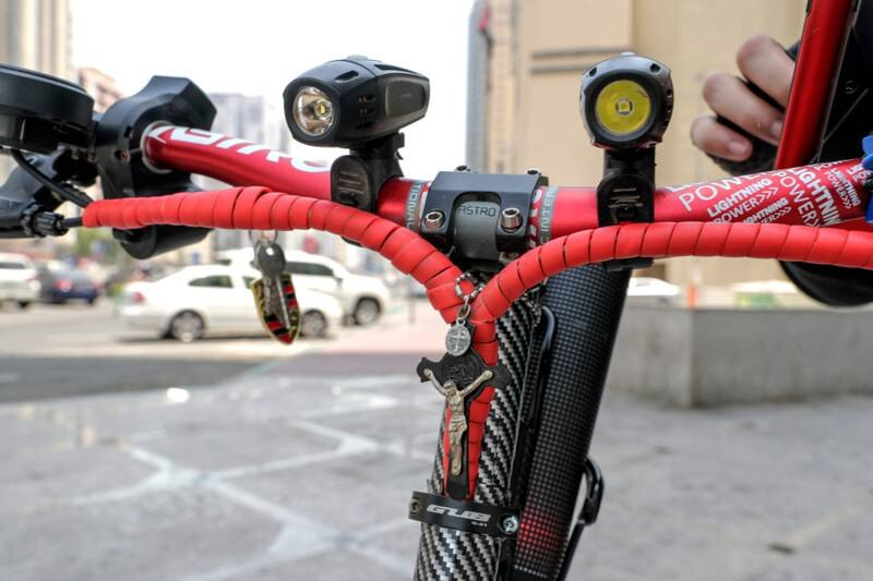 Abu Dhabi, United Arab Emirates, August 13, 2019.  People using E-scooters at the Al Wahda mall area, downtown Abu Dhabi. --  Sam's E-scooter has LED lights for night riding safety, he also never rides without a helmet and his Jesus Christ cross.Victor Besa/The NationalSection:  NAFOR:  Standalone