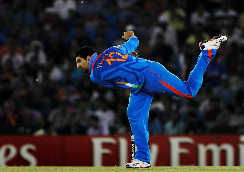 MOHALI, INDIA - MARCH 30:  Yuvraj Singh of India bowls during the 2011 ICC World Cup second Semi-Final between India and Pakistan at Punjab Cricket Association (PCA) Stadium on March 30, 2011 in Mohali, India.  (Photo by Daniel Berehulak/Getty Images)