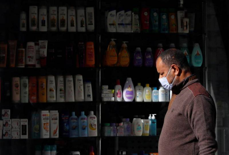 A man walks in front of a pharmacy amid the coronavirus disease (COVID-19) pandemic in Alexandria, Egypt December 6, 2020. REUTERS/Amr Abdallah Dalsh