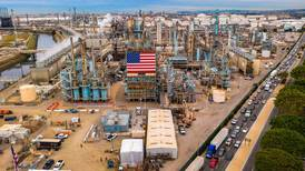 US oil prices rebound but slip again into negative territory after record plunge