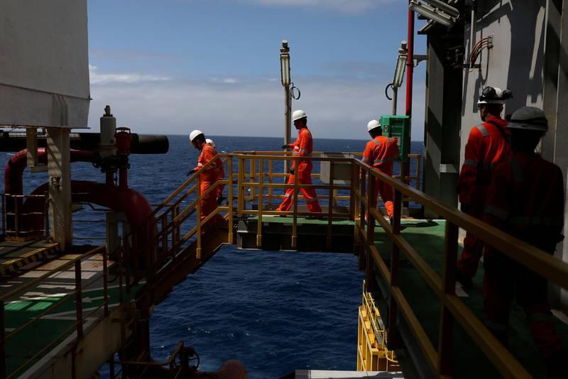 FILE PHOTO: Visitors walk during a visit to Brazil's Petrobras P-66 oil rig in the offshore Santos basin in Rio de Janeiro, Brazil September 5, 2018. Picture taken September 5. REUTERS/Pilar Olivares/File Photo