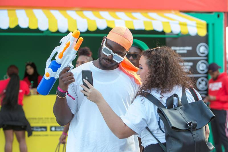Dubai, United Arab Emirates- Visitors taking photos at the Sole Dubai Festival at D3.  Leslie Pableo for The National for Saeed Saeed's story