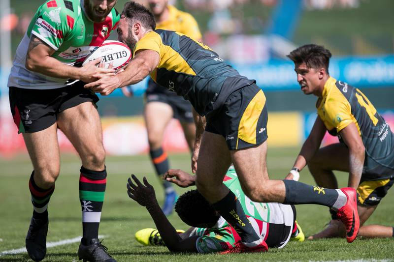 DUBAI, UNITED ARAB EMIRATES - DECEMBER 1, 2018. DUBAI HURRICANES, yellow, win the GULF MEN'S LEAGUE game against ABU DHABI HARLEQUINS, on the final day of this year's Dubai Rugby Sevens.(Photo by Reem Mohammed/The National)Reporter: Section:  NA POAN