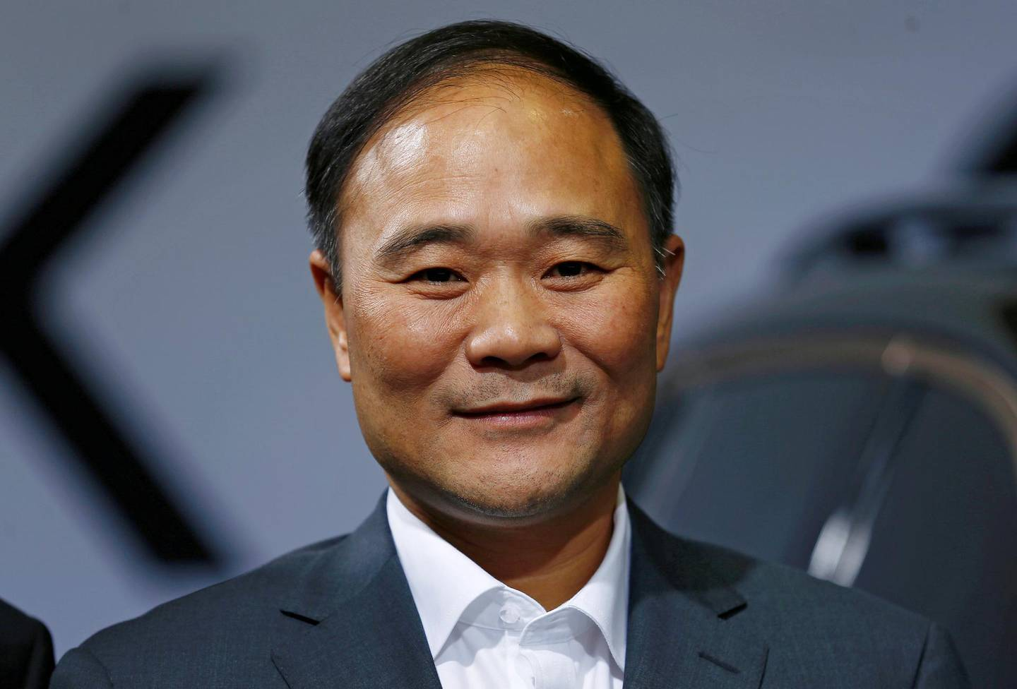 FILE PHOTO: Geely's founder and chairman, Li Shufu, poses for a picture during an event in Berlin, Germany, October 20, 2016. REUTERS/Hannibal Hanschke/File Photo