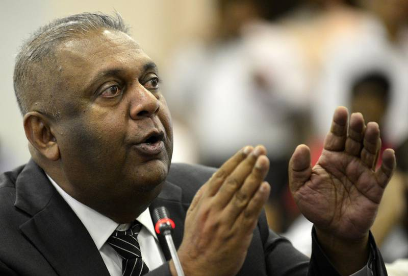 Mangala Samaraweera (R) -- a loyalist MP for Ranil Wickremesinghe -- speaks at a meeting with speaker Karu Jayasuriya at the Parliament Building in Colombo on November 2, 2018. Sri Lanka's speaker on November 2 summoned the country's parliament to meet next week in defiance of the president as a constitutional crisis darkened with an MP telling how he was offered millions of dollars and a minister's post to defect to a rival camp.  / AFP / LAKRUWAN WANNIARACHCHI