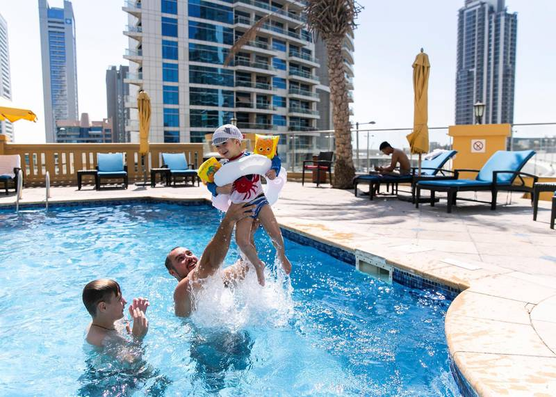 DUBAI, UNITED ARAB EMIRATES. 11 OCTOBER 2020. Only 5 are allowed inside the pool at the same time, as part of the  covid safety measures taken at Ramada Hotel and Suites by Wyndham Dubai JBR.(Photo: Reem Mohammed/The National)Reporter:Section: