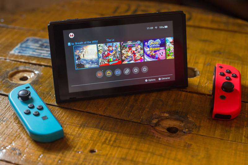 BANGKOK, THAILAND - 2018/04/27:  In this photo illustration, a turned on Nintendo Switch with 2 Joy-Con in front of it. The Kyoto based video game company Nintendo ended its comeback year with revenue worth $9 Billion after a glorious 2017 notably with the launch of the hybrid console the Nintendo Switch, mini retro vintage game consoles such as the Nintendo Entertainment System and Super Nintendo as well as its mobile phone video games. Also Nintendo will welcome its new president Shuntaro Furukawa in the month of June 2018. (Photo Illustration by Guillaume Payen/SOPA Images/LightRocket via Getty Images)