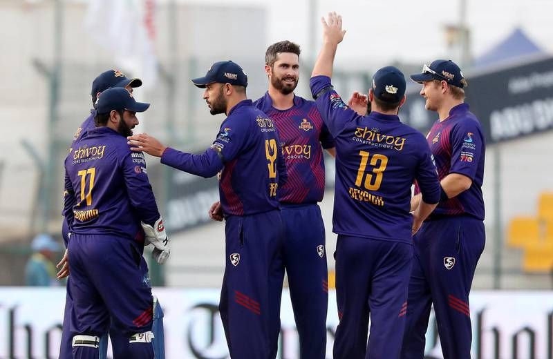 ABU DHABI , UNITED ARAB EMIRATES , Nov 19 – 2019 :- Ben Cutting (center) of Deccan Gladiators celebrating after taking the wicket of  Luke Ronchi during the Abu Dhabi T10 Cricket match between Qalanders vs Deccan Gladiators at Sheikh Zayed Cricket Stadium in Abu Dhabi. ( Pawan Singh / The National )  For Sports. Story by Paul