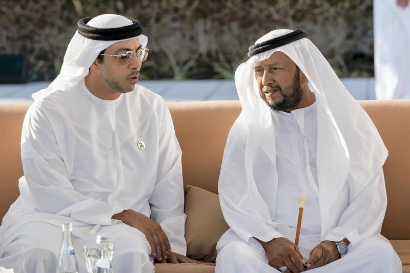 ABU DHABI, UNITED ARAB EMIRATES - November 30, 2017: HH Sheikh Sultan bin Zayed Al Nahyan, UAE President's Representative (R) and HH Sheikh Mansour bin Zayed Al Nahyan, UAE Deputy Prime Minister and Minister of Presidential Affairs (L), attend a Commemoration Day ceremony at Wahat Al Karama, a memorial dedicated to the memory of UAE's National Heroes in honour of their sacrifice and in recognition of their heroism.  ( Rashed Al Mansoori / Crown Prince Court - Abu Dhabi  ) ---