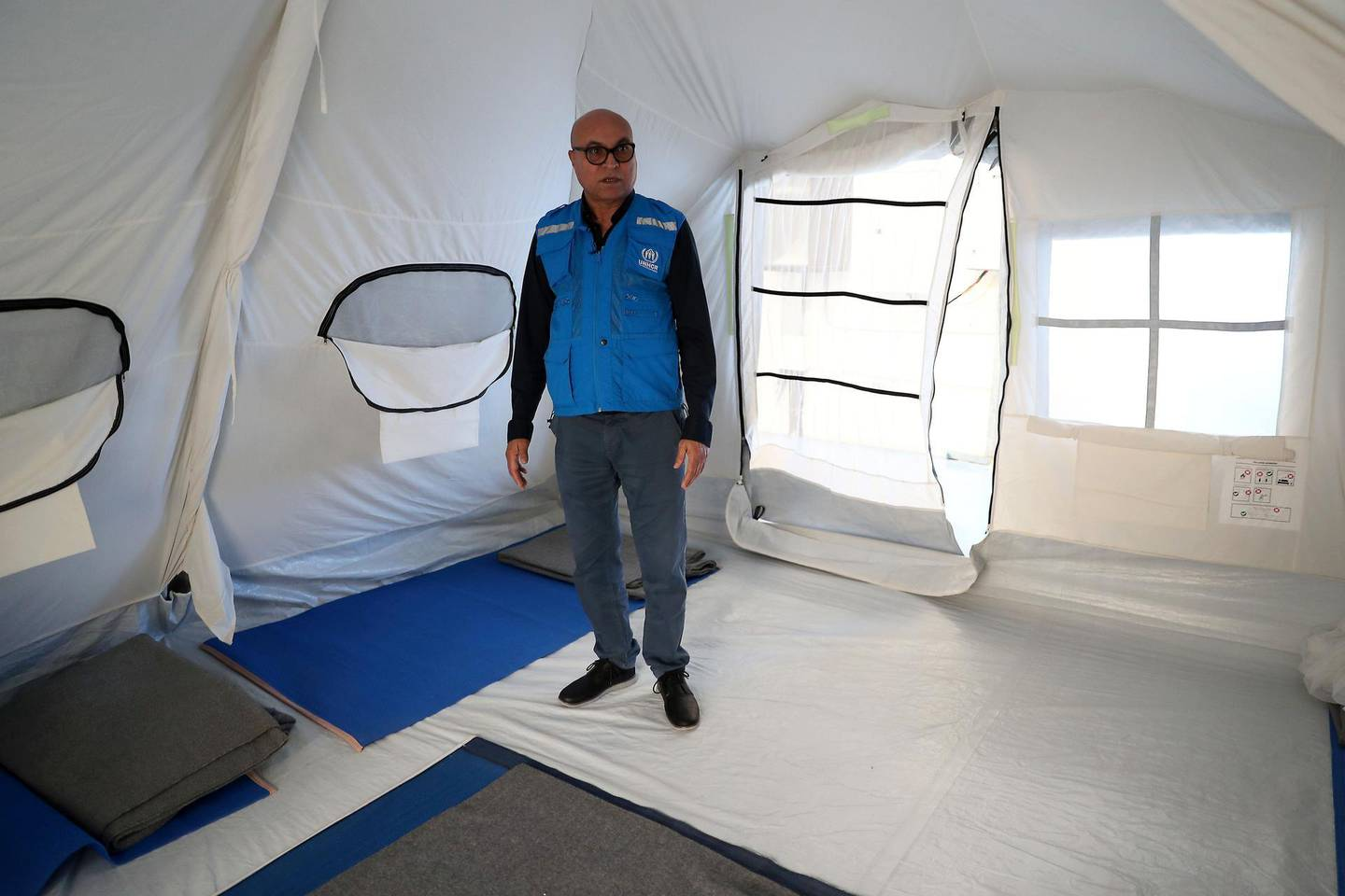 DUBAI, UNITED ARAB EMIRATES , Jan 29  – 2020 :- Muhammad Yaqoob , Head of Office , Senior Global Supply Officer showing the new tents for emergency help at the UNHCR warehouse at the International Humanitarian City in Dubai. ( Pawan  Singh / The National ) For News. Story by Kelly
