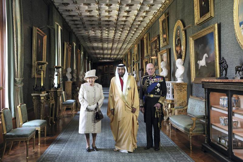 WINDSOR, ENGLAND - APRIL 30:  Queen Elizabeth II (L) and Prince Philip, Duke of Edinburgh (R), greet The President of the United Arab Emirates, His Highness Sheikh Khalifa bin Zayed Al Nahyan (C), in Windsor Castle on April 30, 2013 in Windsor, England. The President of the United Arab Emirates is paying a two-day State Visit to the United Kingdom, staying in Windsor Castle as the guest of Her Majesty The Queen from April 30, 2013 to May 1, 2013. Sheikh Khalifa will meet the British Prime Minister David Cameron tomorrow at his Downing Street residence.  (Photo by Oli Scarff/Getty Images)