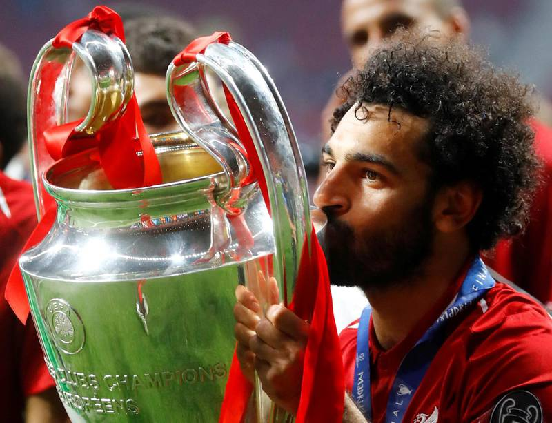 Soccer Football - Champions League Final - Tottenham Hotspur v Liverpool - Wanda Metropolitano, Madrid, Spain - June 1, 2019  Liverpool's Mohamed Salah kisses the trophy as he celebrates after winning the Champions League  REUTERS/Kai Pfaffenbach     TPX IMAGES OF THE DAY