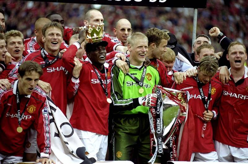 16 May 1999:  Manchester United players celebrate winning the title during the FA Carling Premiership match against Tottenham Hotspur played at Old Trafford in Manchester, England.  The match finished in a 2-1 win for Manchester United and they clinchedtheir 5th Premiership title in seven years. \ Mandatory Credit: Shaun Botterill /Allsport / Getty Images
