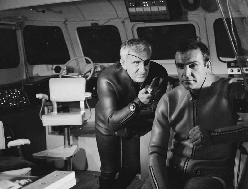 Superspy James Bond, played by actor Sean Connery (right), is held at knifepoint by Adolfo Celi as Emilio Largo in a scene from the film 'Thunderball', being filmed at Pinewood Studios, UK, 1965. (Photo by Stephan C Archetti/Keystone/Hulton Archive/Getty Images)