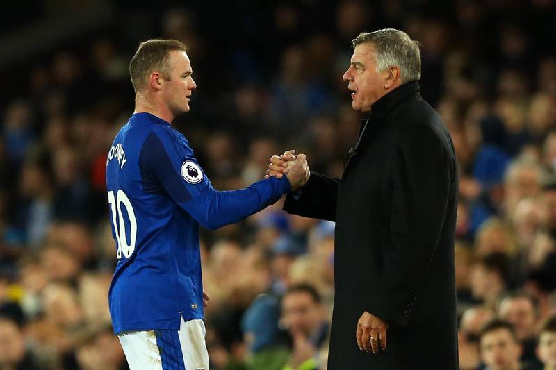 LIVERPOOL, ENGLAND - DECEMBER 02: Wayne Rooney of Everton and Sam Allardyce, Manager of Everton shake hands during the Premier League match between Everton and Huddersfield Town at Goodison Park on December 2, 2017 in Liverpool, England.  (Photo by Jan Kruger/Getty Images)