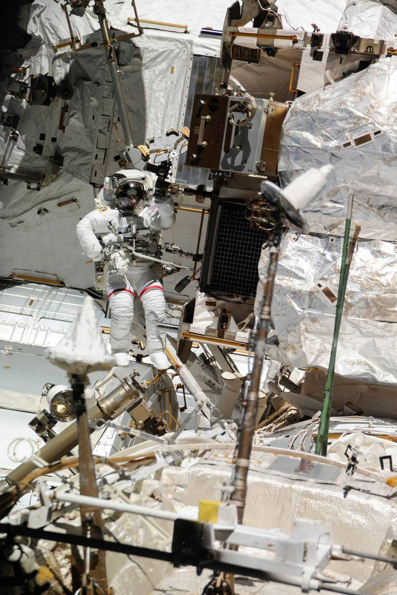 Extravehicular Mobility Unit - ISS036-E-020926 (16 July 2013) --- NASA astronaut Chris Cassidy, Expedition 36 flight engineer, attired in an Extravehicular Mobility Unit (EMU) spacesuit, participates in a session of extravehicular activity (EVA) as work continues on the International Space Station. A little more than one hour into the spacewalk, European Space Agency astronaut Luca Parmitano (out of frame) reported water floating behind his head inside his helmet. The water was not an immediate health hazard for Parmitano, but Mission Control decided to end the spacewalk early. Courtesy Nasa