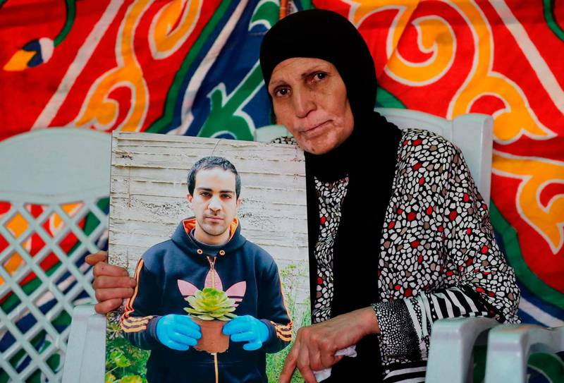 The mother of Iyad Hallak, a 32-year-old Palestinian man with autism who was shot dead by Israeli police when they mistakenly thought he was armed with a pistol, mourns her son at their home in annexed east Jerusalem on June 1, 2020 Last week a police officer who believed he was armed shot him dead, leaving his family searching for answers and igniting widespread grief and anger. Thousands of mourners massed for his funeral while the social media hashtag #PalestinianLivesMatter echoed fury over police violence and racism in the United States. Hallak, brown-haired, well-built and with broad shoulders, cut an imposing figure but had the mental age of an eight-year-old, according to his bereaved family.  / AFP / AHMAD GHARABLI