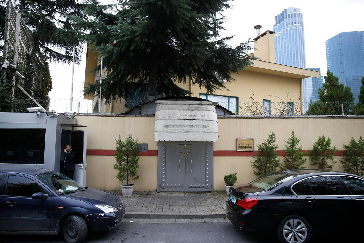 """A security guard stands outside Saudi Arabia's consulate in Istanbul, Saturday, Oct. 20, 2018. Saudi Arabia claims Saudi journalist Jamal Khashoggi died in a """"fistfight"""" in consulate, finally admitting that the writer had been slain at its diplomatic post. The overnight announcements in Saudi state media came more than two weeks after Khashoggi, 59, entered the building for paperwork required to marry his Turkish fiancée, and never came out.(AP Photo/Lefteris Pitarakis)"""