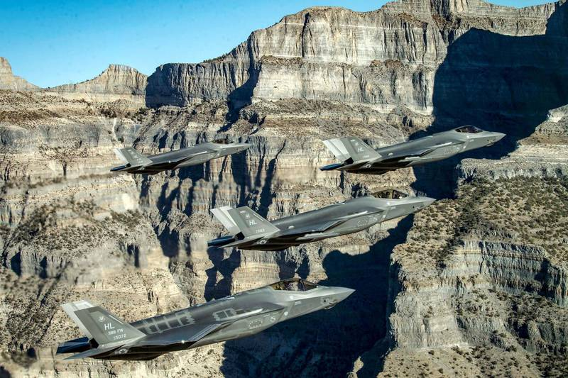 FILE PHOTO: A formation of U.S. Air Force F-35 Lightning II fighter jets perform aerial maneuvers during as part of a combat power exercise over Utah Test and Training Range, Utah, U.S. November 19, 2018. Picture taken November 19, 2018. U.S. Air Force/Staff Sgt. Cory D. Payne/Handout via REUTERS. ATTENTION EDITORS - THIS IMAGE WAS PROVIDED BY A THIRD PARTY/File Photo