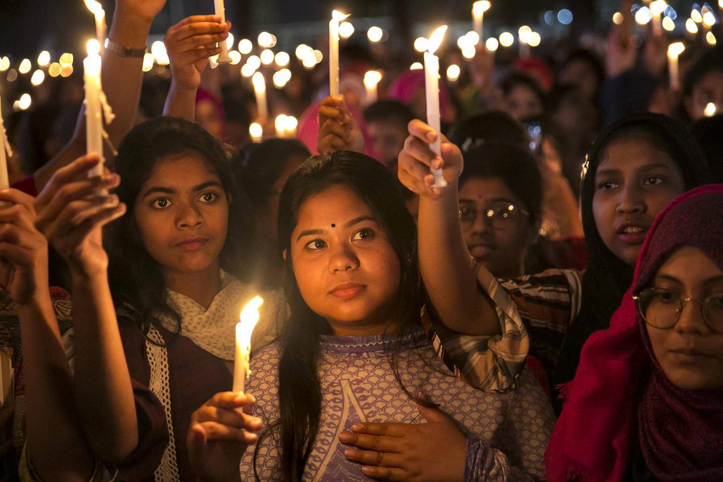 DHAKA, BANGLADESH - MARCH 08: Women attend a candlelight vigil in the early hours of March 8, 2020 in Dhaka, Bangladesh. International Women's Day is observed on March 8 every year, celebrating the achievements of women around the world. (Photo by Allison Joyce/Getty Images) *** BESTPIX ***